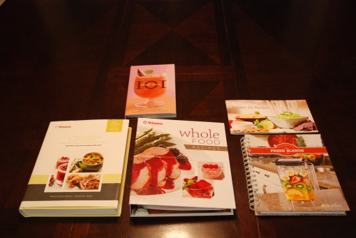 The cookbooks that come with (from left to right) the Vitamix Professional Series 300, Vitamix 5200, Blendtec Twister Jar (top) and Designer Series (bottom). (101 Blender Drinks [top] also included for scale)