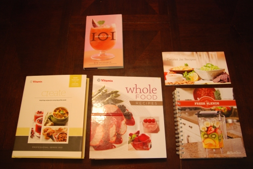 Another view of cookbooks that come with the Vitamix Professional Series 300, Vitamix 5200, Twister Jar (top) and Blendtec Designer Series (bottom).