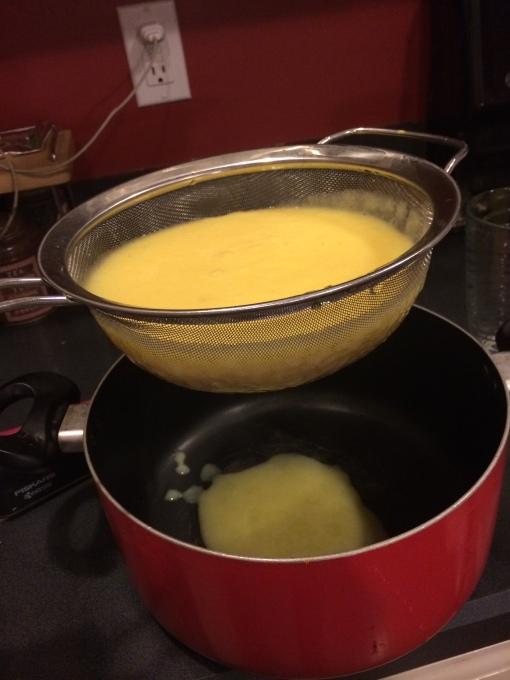 Attempting to strain Fresh Orange Applesauce